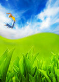 Woman jumping in the field Royalty Free Stock Image