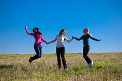Woman jumping into the field against the s Royalty Free Stock Photo