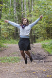 Woman jumping in a forest Stock Photos