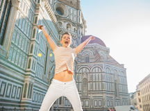 Woman jumping in front of cattedrale in florence Royalty Free Stock Image