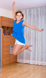 Woman jumping full of happiness Royalty Free Stock Photo