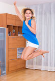 Woman jumping full of happiness Stock Photo