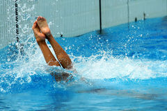 Woman jumping getting into water Royalty Free Stock Photos