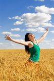 Woman jumping in golden wheat Stock Photos