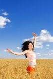 Woman jumping in golden wheat Royalty Free Stock Photo