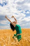 Woman jumping in golden wheat Stock Images