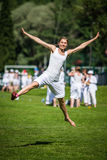 Woman jumping on grass field Royalty Free Stock Image