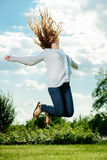 Woman jumping on the green grass Royalty Free Stock Images