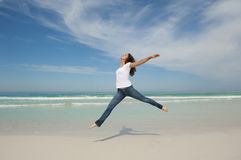 Woman Jumping Happy At Beach Stock Images