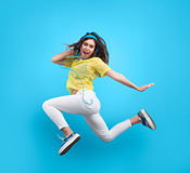 Woman jumping in headphones royalty free stock photography