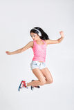 Woman jumping in headphones to music royalty free stock photography