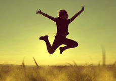 Woman jumping high at sunset. Young happiness woman jumping high at sunset Royalty Free Stock Photos