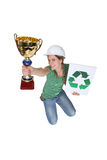 Woman jumping and holding a trophy Royalty Free Stock Photography