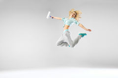 Woman jumping and holding a white roller Royalty Free Stock Images