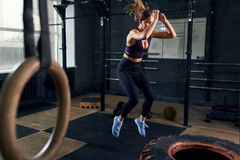 Woman Jumping on Huge Tire in CrossFit Gym royalty free stock photos