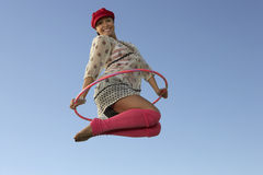 Woman Jumping With Hula Hoop Stock Photo
