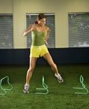 Woman jumping hurdles. stock photography