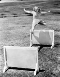 Woman jumping hurdles labeled with years Royalty Free Stock Photo