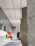Woman Jumping Hurdles In Portico Stock Photography