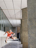Woman Jumping Hurdles In Portico Royalty Free Stock Photo