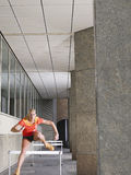 Woman Jumping Hurdles In Portico Royalty Free Stock Images