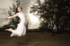 Woman Jumping In The Park Stock Image