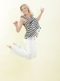 Woman jumping for joy Stock Photography