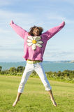 Woman jumping for joy Royalty Free Stock Photo