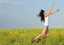 Woman jumping for joy Royalty Free Stock Images