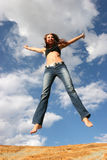 Woman jumping of joy Royalty Free Stock Photos