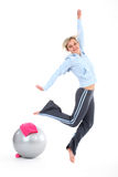 Woman jumping with joy. Blond woman jumping with joy in her gym outfit Stock Images