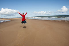 Woman jumping for joy Stock Images