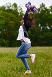 Woman jumping for joy. Young woman jumping for joy outdoor in the park Stock Photos