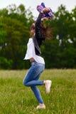 Woman jumping for joy Stock Photos