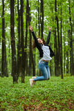 Woman jumping for joy. Young woman jumping for joy outdoor in the park Royalty Free Stock Photos