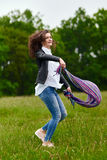 Woman jumping for joy. Young woman jumping for joy outdoor in the park Royalty Free Stock Photo