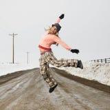 Woman jumping joyfully. royalty free stock photo
