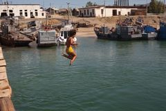 Woman jumping in lake Stock Photography
