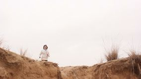 Woman jumping nature in autumn nature sand stock video