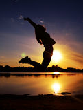 Woman Jumping Near Body of Water Royalty Free Stock Images