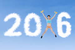 Woman Jumping with Numbers 2016 Stock Images