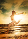 Woman Jumping On A Beach Stock Photos