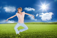Woman jumping and opening arms Royalty Free Stock Photo