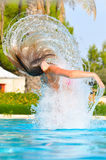 Woman is jumping out of pool Royalty Free Stock Photos