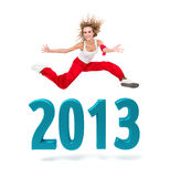 Woman jumping over a 2013 New Year sign. Smiling woman jumping over a 2013 New Year sign against isolated white background Stock Photo