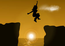 woman jumping over cliff Stock Photography