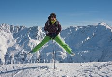Woman  jumping over the snowy mountains, austria Stock Image