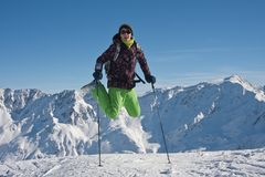 Woman  jumping over the snowy mountains, austria Royalty Free Stock Image