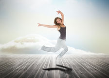 Woman jumping over wooden boards Royalty Free Stock Images