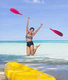 Woman jumping with a paddle stock photos